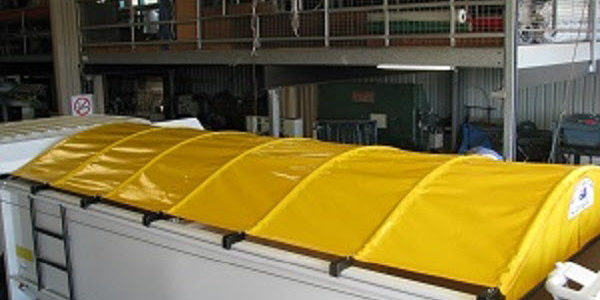 Wind out truck tarps.